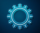Glowing neon line Sun icon isolated on blue background. Summer symbol. Good sunny day. Vector Illustration