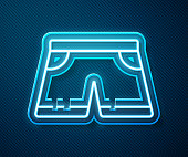 istock Glowing neon line Swimming trunks icon isolated on blue background. Vector Illustration 1254801392