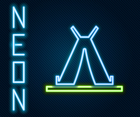 Glowing neon line Traditional indian teepee or wigwam icon isolated on black background. Indian tent. Colorful outline concept. Vector Illustration