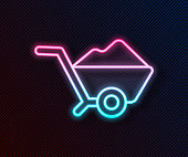 Glowing neon line Wheelbarrow with dirt icon isolated on black background. Tool equipment. Agriculture cart wheel farm. Vector Illustration