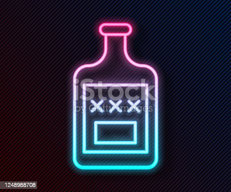 istock Glowing neon line Whiskey bottle icon isolated on black background. Vector Illustration 1248988708