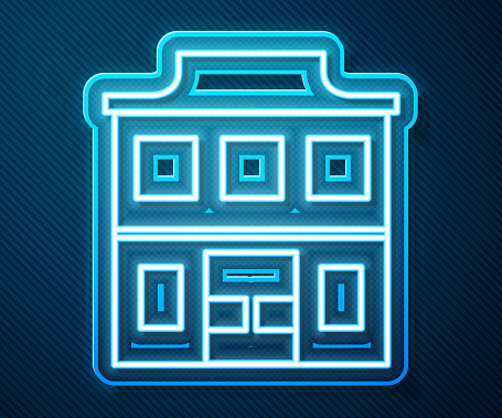 Glowing neon line Wild west saloon icon isolated on blue background. Old west building. Vector Illustration