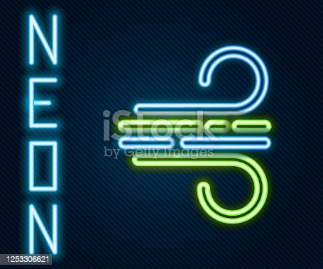 istock Glowing neon line Wind icon isolated on black background. Windy weather. Colorful outline concept. Vector Illustration 1253306621