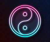Glowing neon line Yin Yang symbol of harmony and balance icon isolated on black background. Vector Illustration