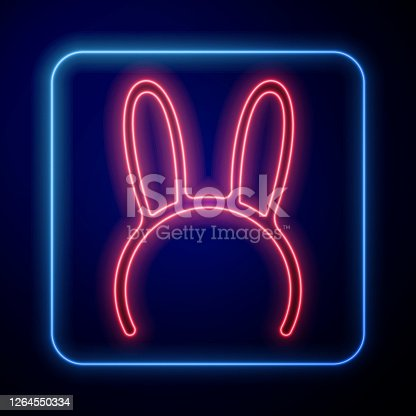 istock Glowing neon Mask with long bunny ears icon isolated on blue background. Vector Illustration 1264550334