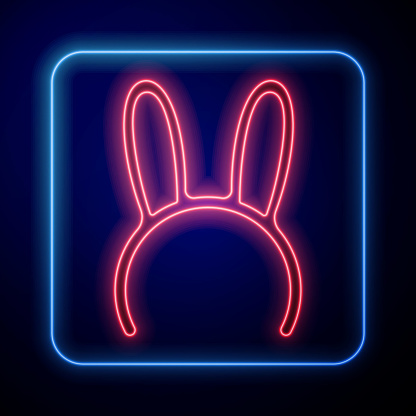 Glowing neon Mask with long bunny ears icon isolated on blue background. Vector Illustration