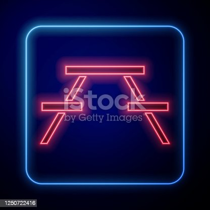 Glowing neon Picnic table with benches on either side of the table icon isolated on blue background. Vector Illustration