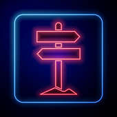 istock Glowing neon Road traffic sign. Signpost icon isolated on blue background. Pointer symbol. Street information sign. Direction sign. Vector Illustration 1266094456