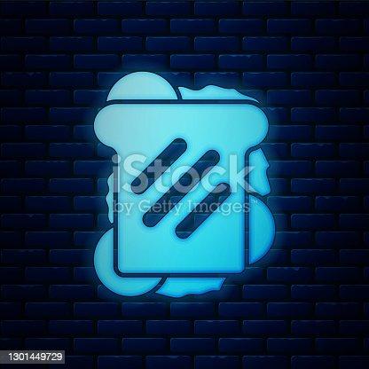 istock Glowing neon Sandwich icon isolated on brick wall background. Hamburger icon. Burger food symbol. Cheeseburger sign. Street fast food menu. Vector 1301449729