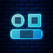 Glowing neon Set Bandage plaster icon isolated on brick wall background. Medical plaster, adhesive bandage, flexible fabric bandage. Vector Illustration