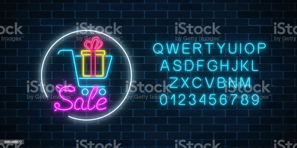 Glowing neon sign of supermarket shopping cart with gift box and alphabet. Luminous advertising sale banner. Glowing neon sign of supermarket shopping cart with gift box and alphabet on a dark brick wall background. Luminous advertising sale banner. Neon light effects store basket. Vector illustration. Alphabet stock vector