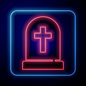 Glowing neon Tombstone with cross icon isolated on blue background. Grave icon. Happy Halloween party. Vector