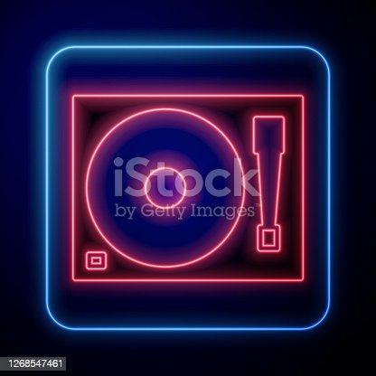 istock Glowing neon Vinyl player with a vinyl disk icon isolated on blue background. Vector Illustration 1268547461