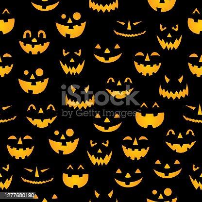 istock Glowing Pumpkin Faces Seamless Pattern 1277680190