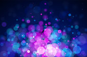 Abstract vector fuchsia and blue bokeh background. The eps file is organised into layers for the background, the bokeh, the lights and the stars.