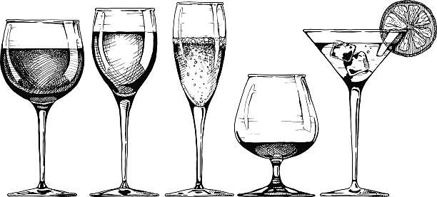 goblet set Vector set of glasses goblets in ink hand drawn style. isolated on white. martini glass stock illustrations
