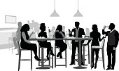 A vector silhouette illustration of a gourp of young adults at a bar celebrating with alcoholic beverages.  Young men and women sit and stand around a table.