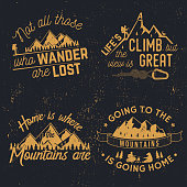 Going to the mountains is going home. Vector illustration. Concept for shirt or logo, print, stamp or tee. Mountains related typographic quote. Retro t shirt design