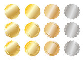 Close up metal achievement and award badges (golden, silver and copper) isolated on white background