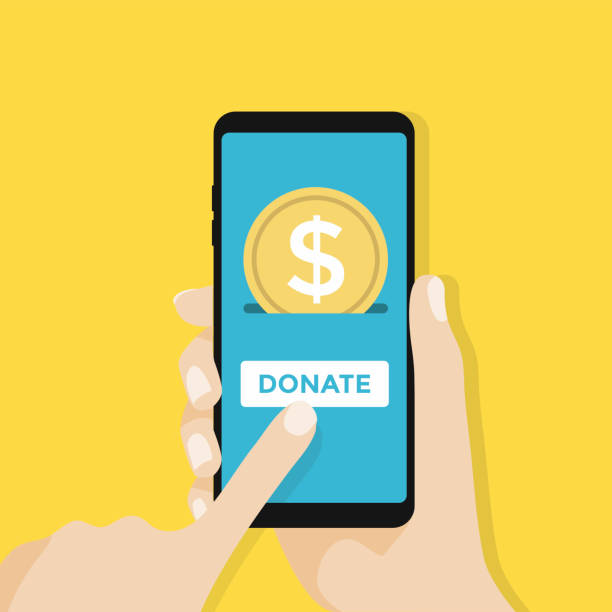 gold coin and donate button on smartphone screen. hand holds smartphone, finger touches screen. vector - hand holding phone stock illustrations