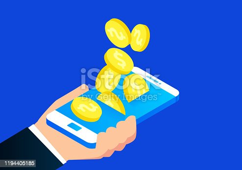 istock Gold coins keep falling into the phone 1194405185