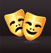 Gold comedy and tragedy theatre masks on a black background