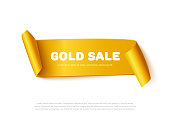 Gold curved paper ribbon banner with rolls and inscription GOLD