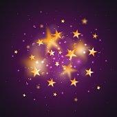 Gold defocused stars on purple background.