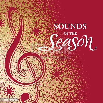 Christmas treble clef and snowflakes cut out from gold dust spreading on red background