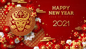 2021 Chinese New Year Greeting Card, Gold Emblem with Bull and Paper cut Sakura Flowers on Red Background. Vector illustration. Hieroglyph - Zodiac Sign Ox. Place for Text