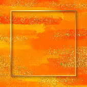 Gold Foil Frame with Orange Watercolor Brush Stroke. Soft Pastel Grunge Texture. Orange Colored Brush Stroke Clip Art. Orange Blot Isolated. Elegant Texture Design Element for Greeting Cards and Labels, Abstract Background.