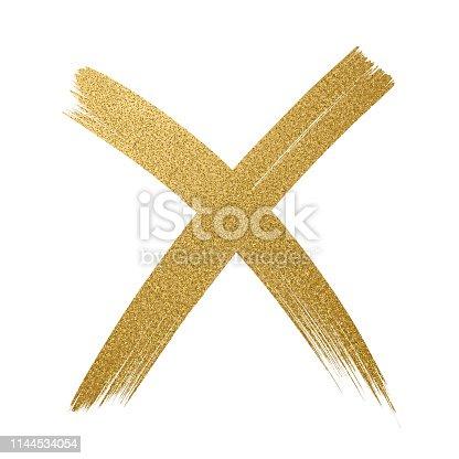 istock Gold Glitter Icon. Cross shape. Checkmark OK icon. Glitter golden brush stroke on white background. 1144534054