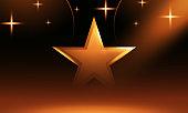 Gold glitter star vector isolated on dark background. Golden sparkle luxury design element isolated. Icon of star isolated on dark background. stock illustration