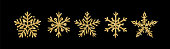 Gold glitter texture snowflake hand drawn icons set on black background. Shiny Christmas, New year and winter sparkling golden symbols for print, web, decoration, greeting card. Vector Illustration