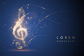 istock Gold light music note on blue background 1203754644
