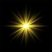 Gold light star on black background