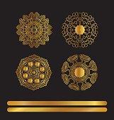 Ethnic vintage pattern. Mandala golden art. Gold circular ornament on black background.