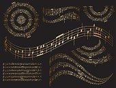gold musical design elements on black - vector set