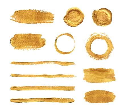 Gold paint brush strokes set. Vector design