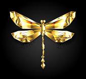 Shiny, polygonal, gold ( golden ) dragonfly on black background.