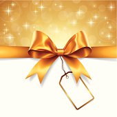 Vector illustration of a gold ribbon with blank tag for text. EPS 10 file with transparencies effects. Gradient mesh used.