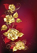gold entwined roses on red textural background