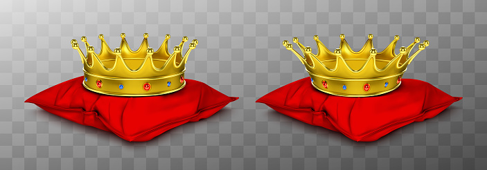Gold royal crown for king and queen on red pillow