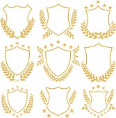 Gold shields and insignias set. Golden shields and laurel wreaths