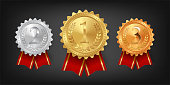 Gold, silver and bronze medals with red ribbons isolated on black background. Vector design element