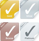 Vectored customer service grade labels with four options of gold, silver, bronze and platinum. This illustration contains an Ai10 compatible transparency effect. The image is first rendered in a 3D programme for realistic lighting, material and reflection, then drawn in illustrator using sophisticated blends. This format can be blown up to any size without loss of quality.