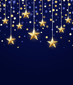Gold star hanging holiday night glitter confetti confetti abstract background.