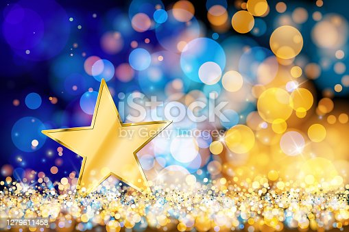 istock Gold star on defocused lights. Blue and gold bokeh decoration 1279611458