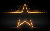 Gold star with glowing sparks effect in vector