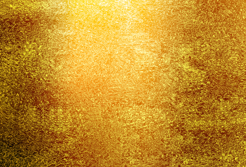 Gold textured background. Golden holiday backdrop.
